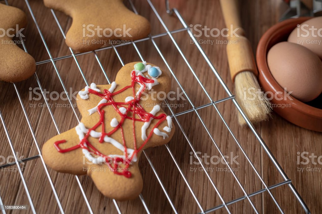 Messy gingerbread man on a wire rack