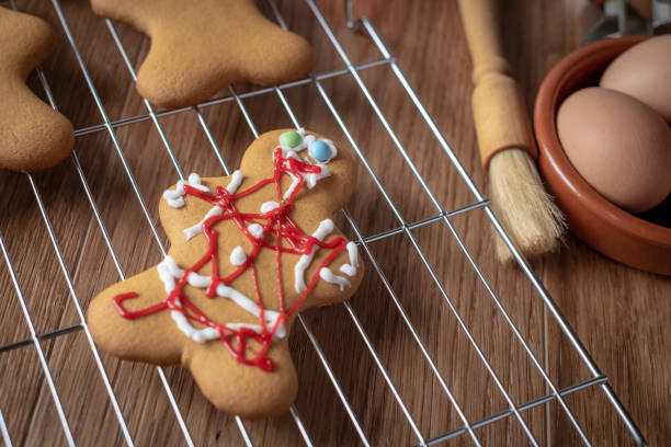 messy gingerbread man - christmas stock photos and pictures