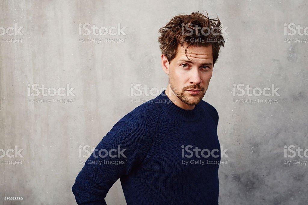 Messy hair guy looking at camera stock photo