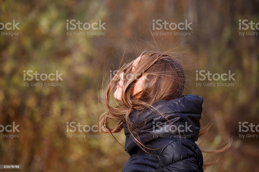 Messy hair of woman, windy autumn day stock photo