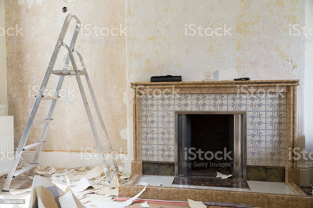 Messy Home Improvement Stripping Wallpaper Around Fireplace Royalty Free Stock Photo