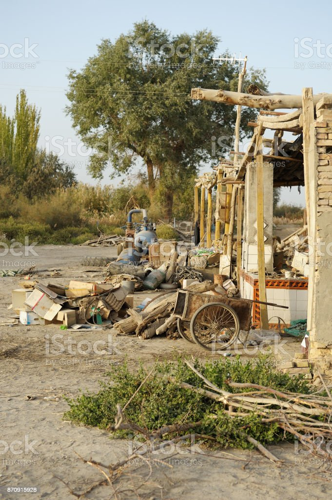 Abandoned objects in front of house, Chinese Xinjiang province