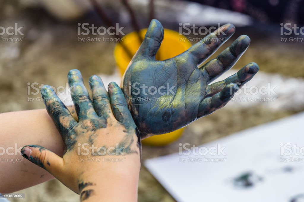 A messy kid hands with watercolor. stock photo