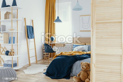 istock Messy kid's bedroom with toys and wooden furniture real photo 1156142614