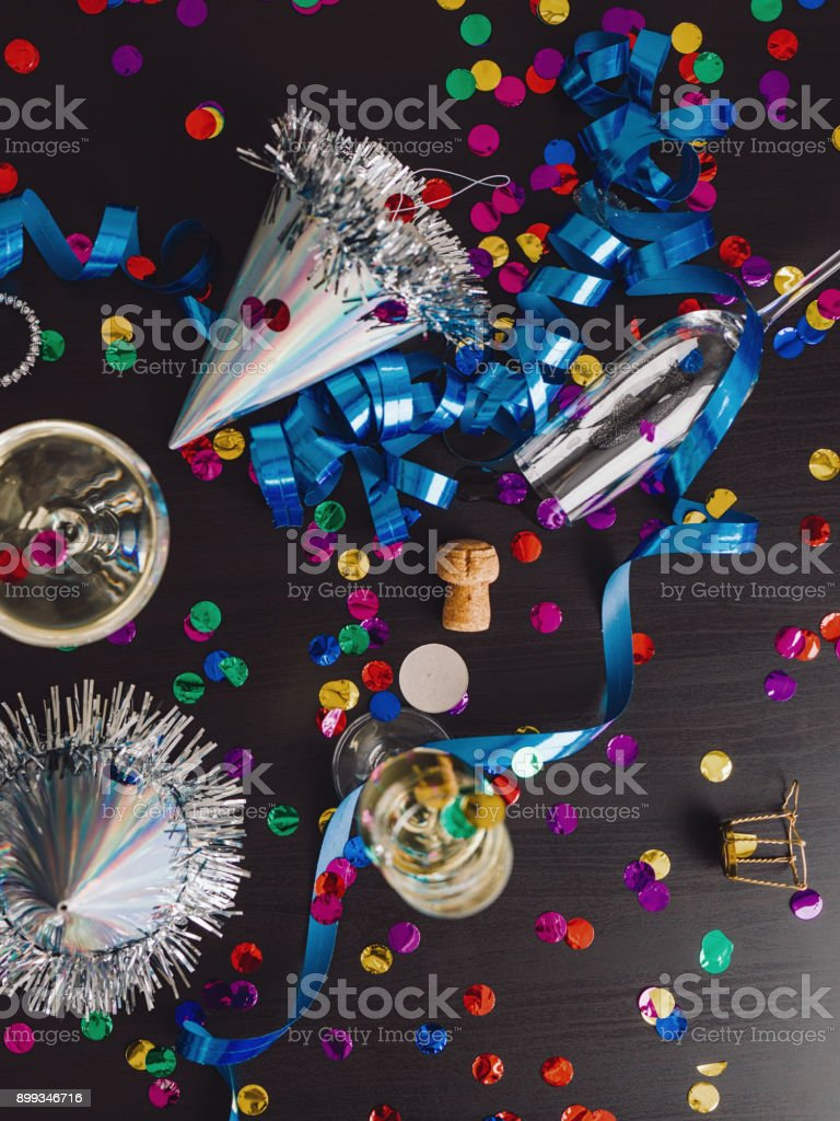 Messy New years still life background party place setting stock photo