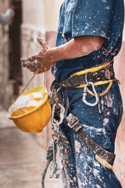 Messy Paint Splattered Muscular Construction Worker stock photo