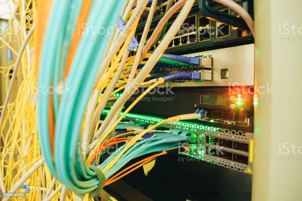messy plex of wires in the server rack of the data center. High-speed...
