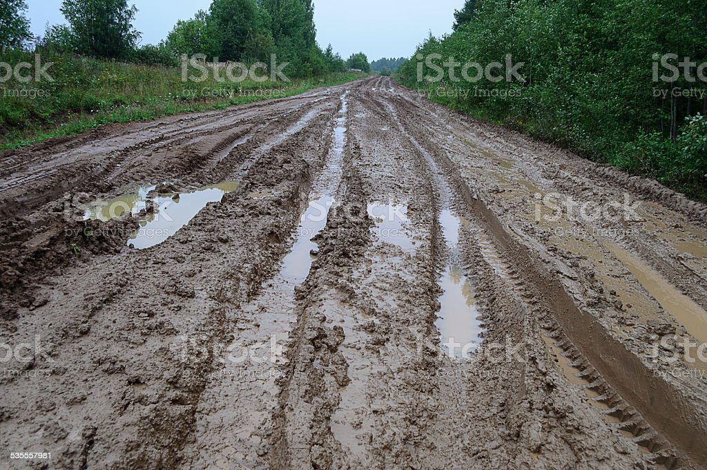 Messy rural dirt road after rain stock photo