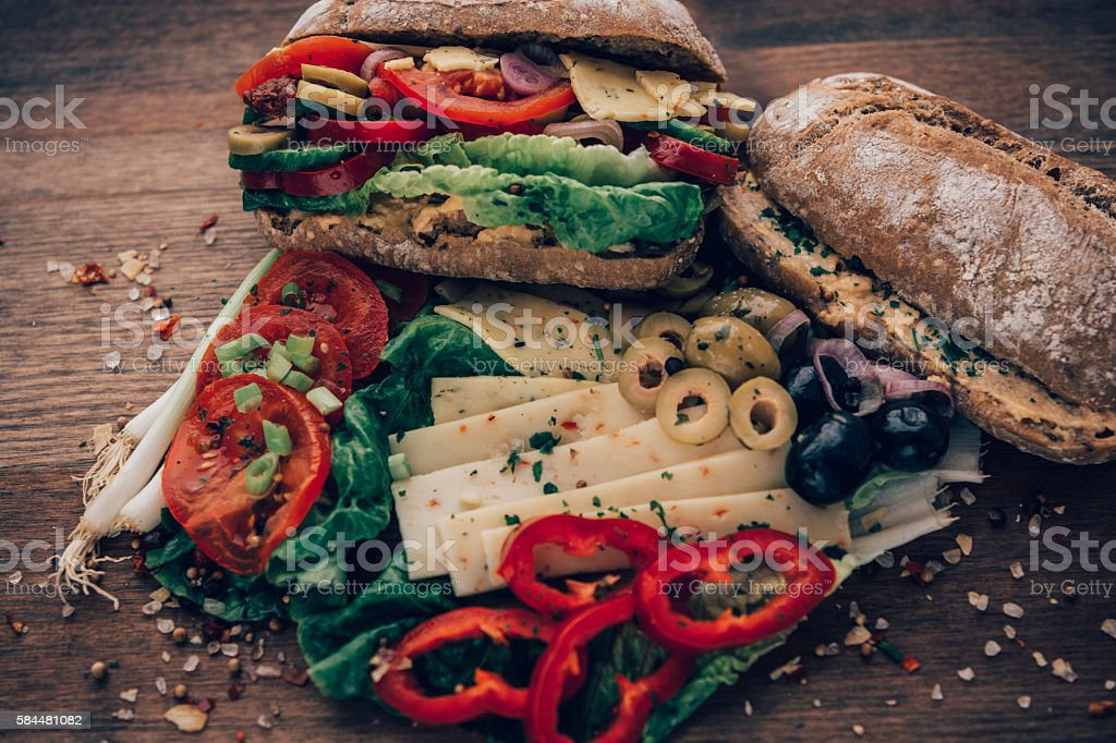 Messy sandwich overflowing with ingredients. stock photo