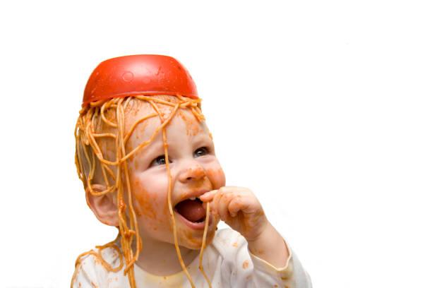 Messy Spaghetti Baby stock photo