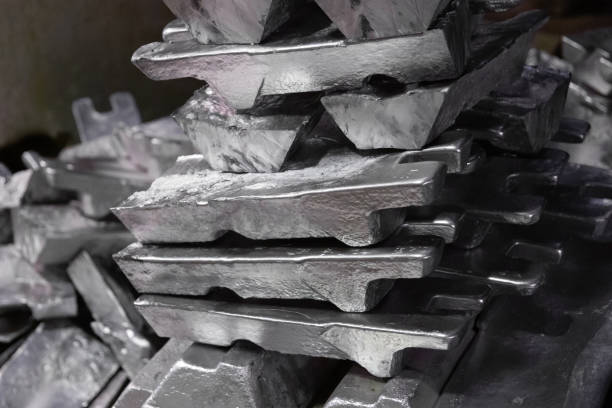 messy stack of aluminium ingots - close-up with selective focus stock photo