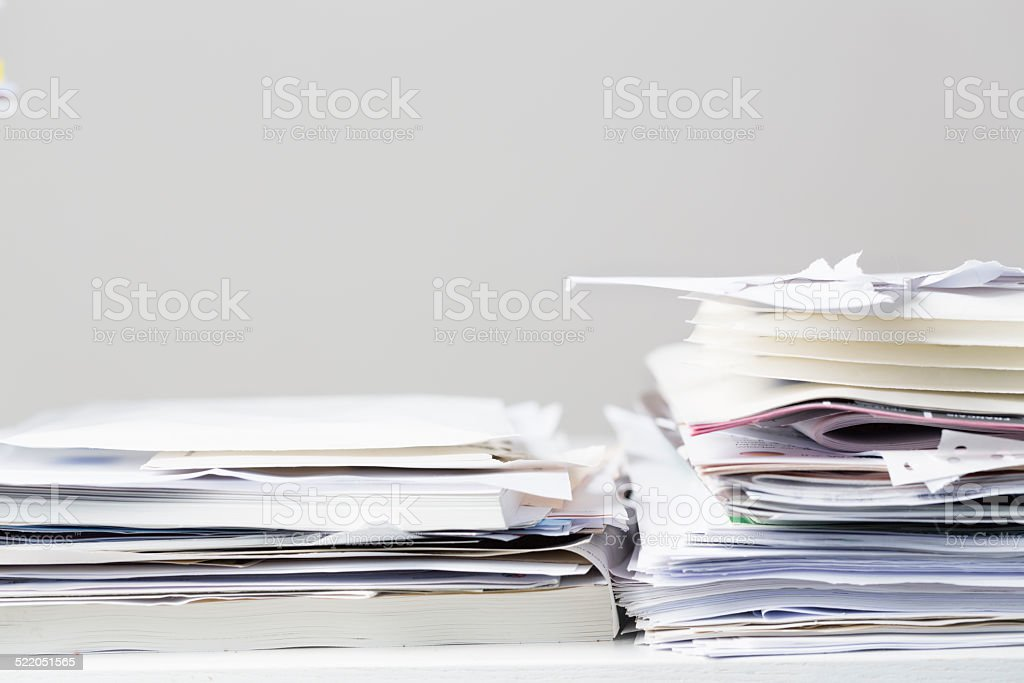 messy stacks of office papers stock photo