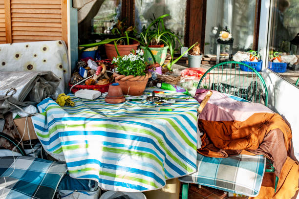 messy storage area of someone with hoarding disorder - hoarding stock photos and pictures