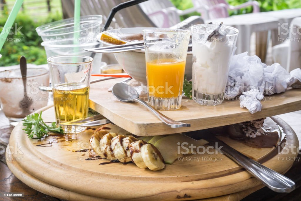 Messy table after eating dessert on the wooden table stock photo