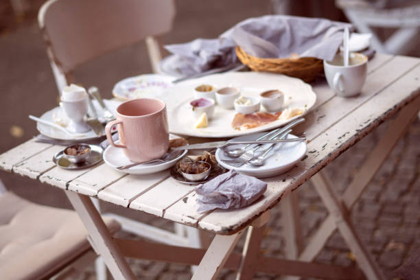 Messy table and dirty dishes after breakfast stock photo