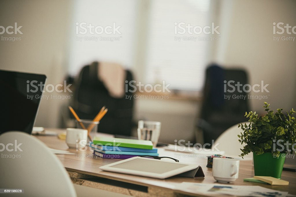 Messy table in modern office with digital tablet stock photo