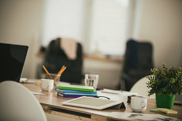 Messy table in modern office with digital tablet Messy table in modern office with digital tablet. messy home office stock pictures, royalty-free photos & images