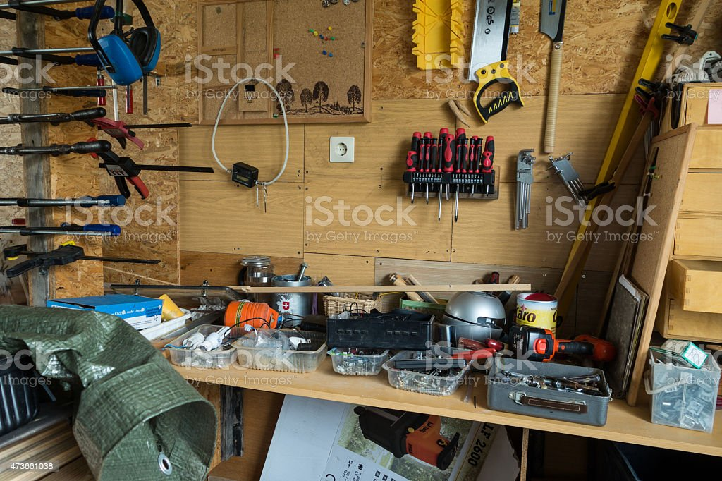 Messy table of tools in a workshop stock photo
