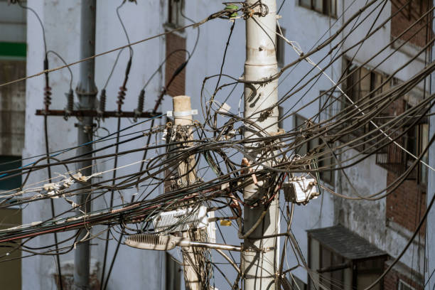 Messy telephone and electric wires stock photo