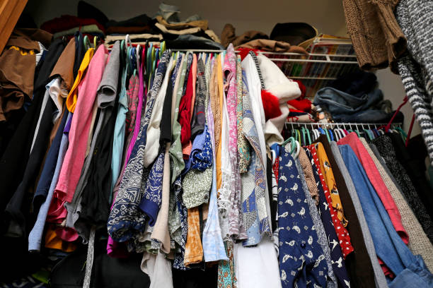 Messy Women's Closet Filled with Colorful Clothes A messy young women's closet is fill with many outfits of colorful clothing, shirts, and dresses. full stock pictures, royalty-free photos & images