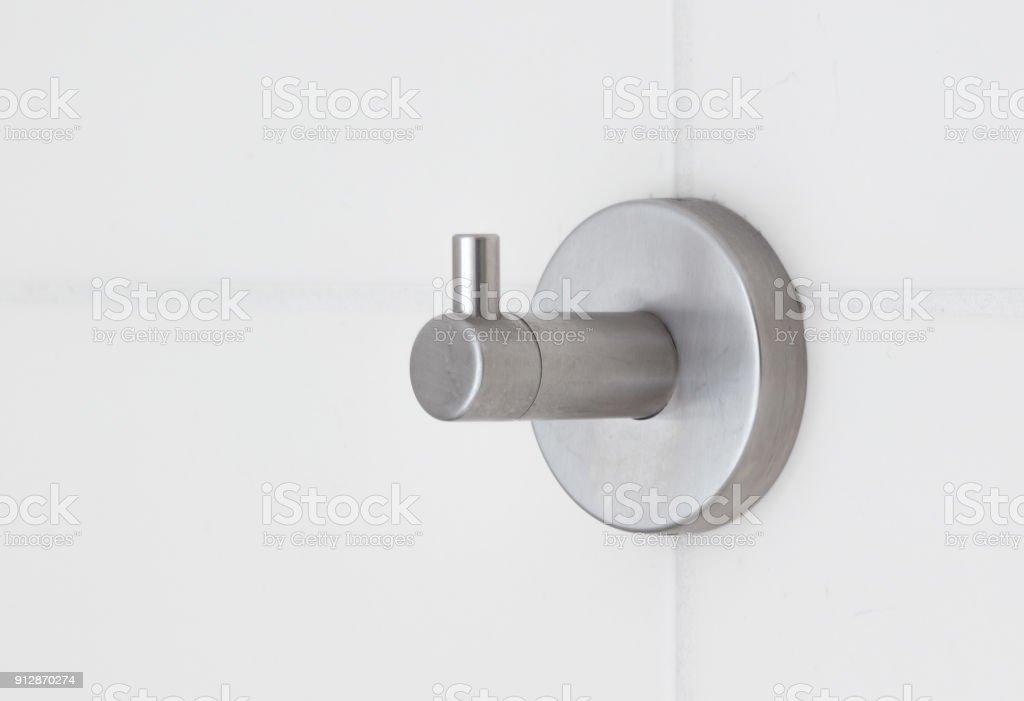 Metal adhesive hook on tiled wall stock photo