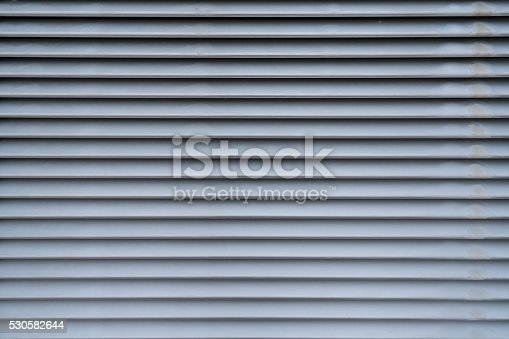 istock Metal air vent abstract background in horizontal pattern 530582644