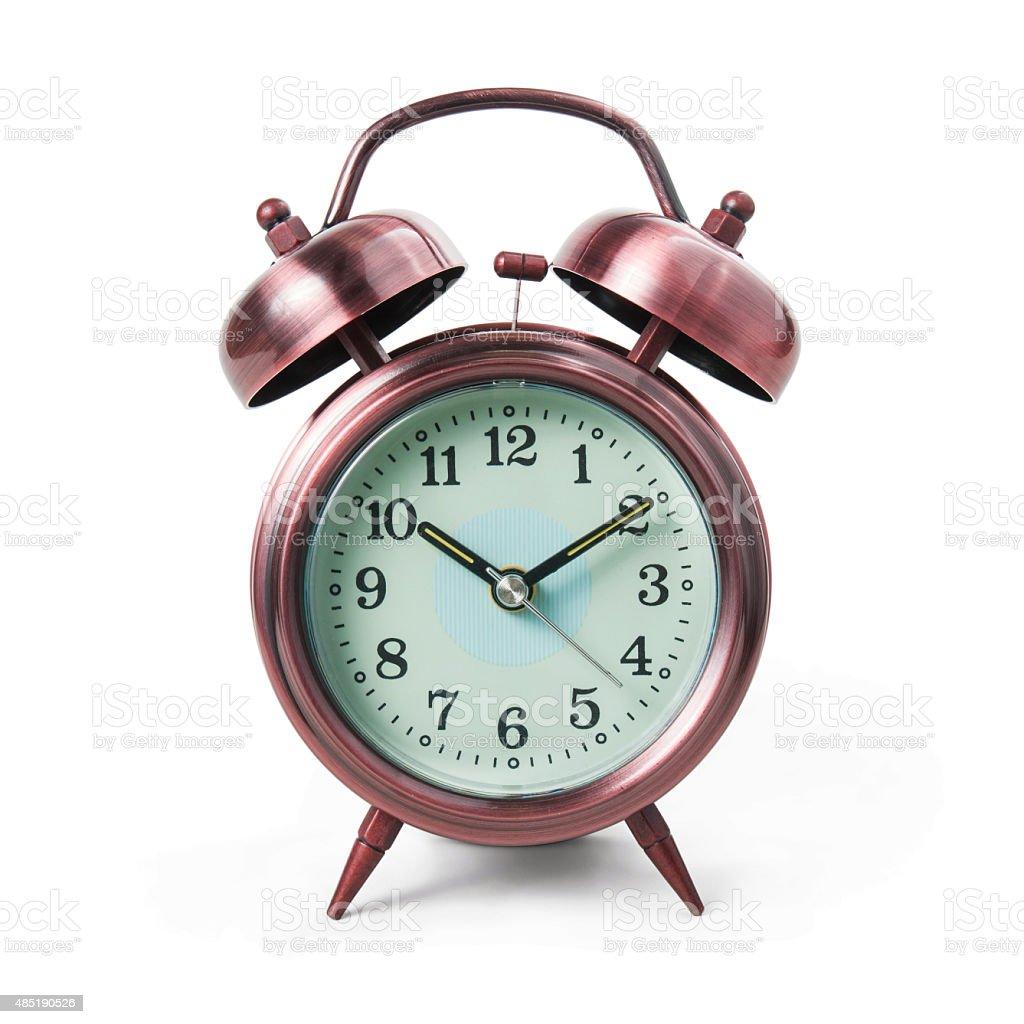 Metal alarm clock isolated on white background. stock photo