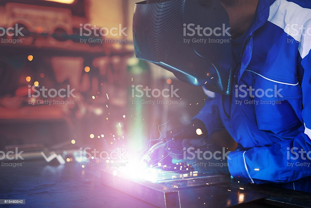 Blue collar worker or engineer working in industrial production...
