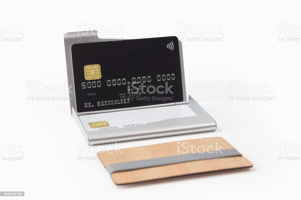 Metall Und Holzvisitenkartenetuis Mit Kreditkarten Stockfoto