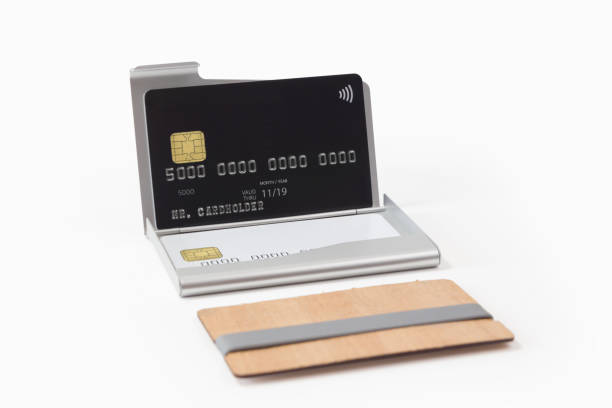 Metal and wooden business card holders with credit cards stock photo