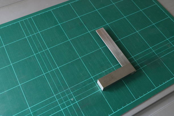 Metal angle square on green cutting mat background stock photo