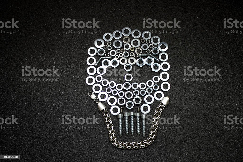 Metal art. Skull made by screw nuts, washers and bolts stock photo