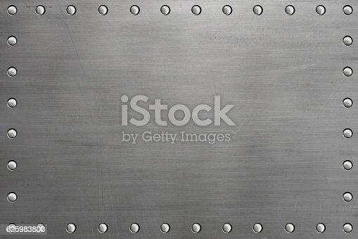 Riveted metal plate, polished steel