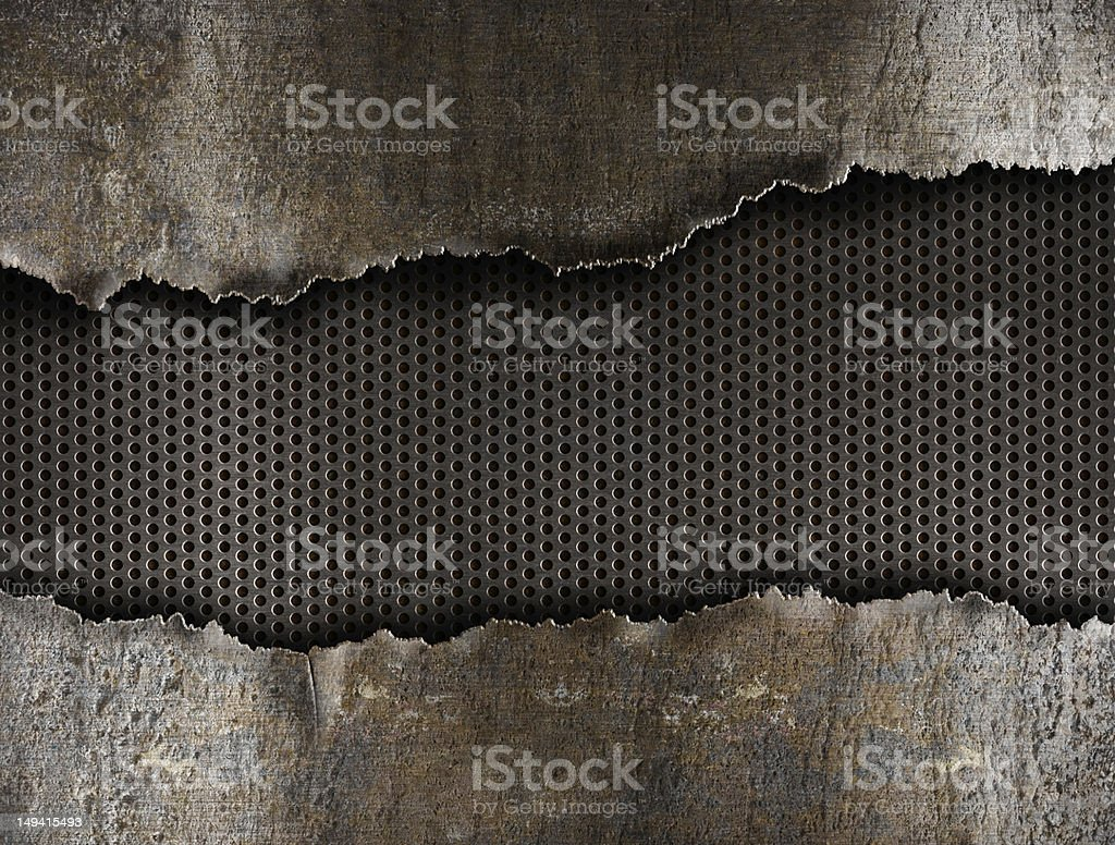 Metal background with a large rip through it stock photo