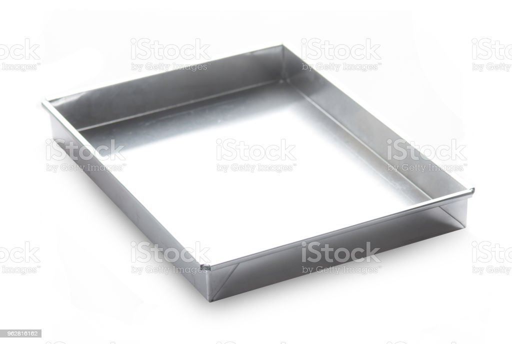 Metal baking pan isolated on white background - Foto stock royalty-free di Acciaio