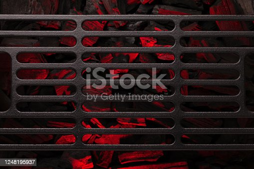 Metal barbecue grill over hot coal. Top view flat lay. Backdrop for your cooking food