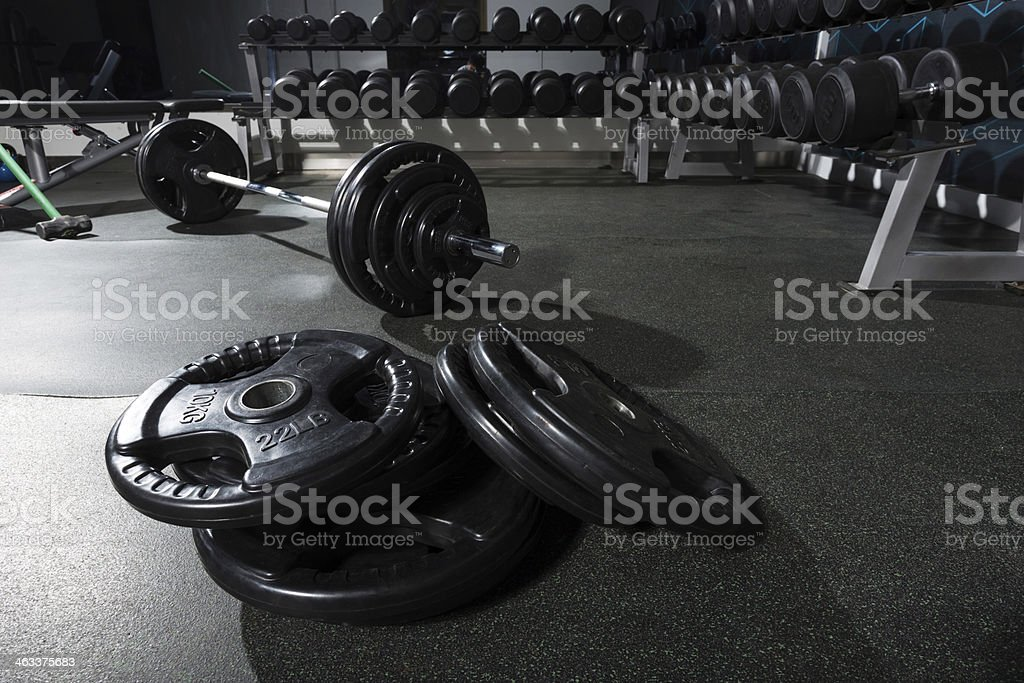 metal barbell on dark gray background stock photo