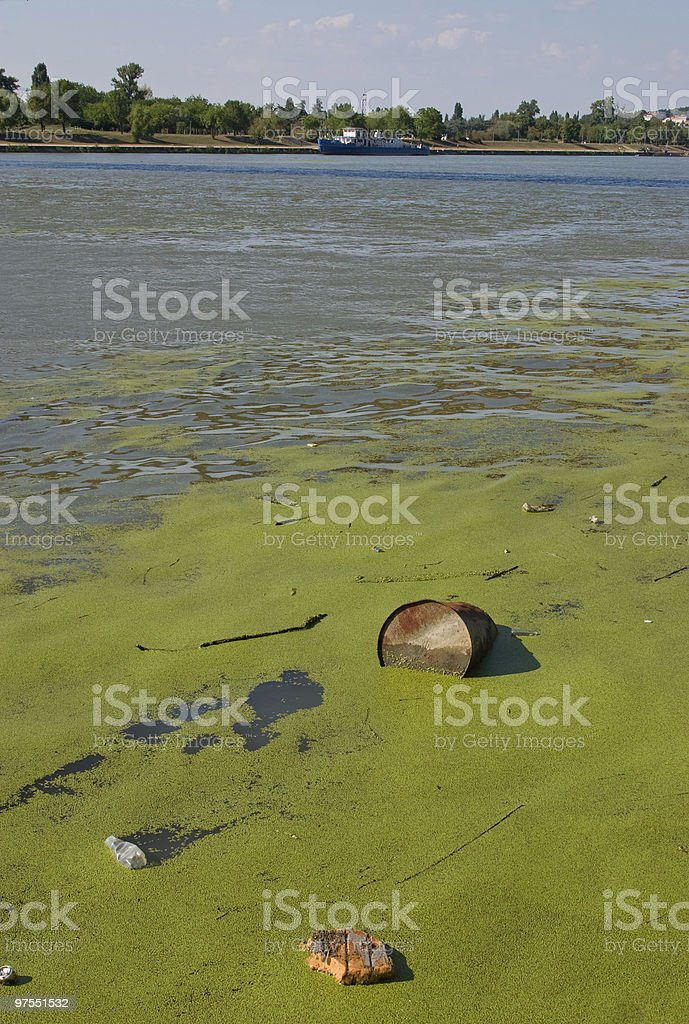 Metal barrel floating in river royalty-free stock photo