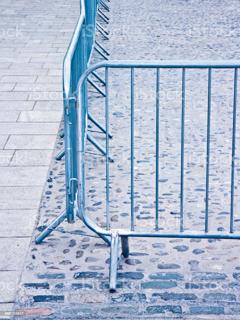 Metal barrier in a stone road - Image with copy space - Royalty-free Closed Stock Photo
