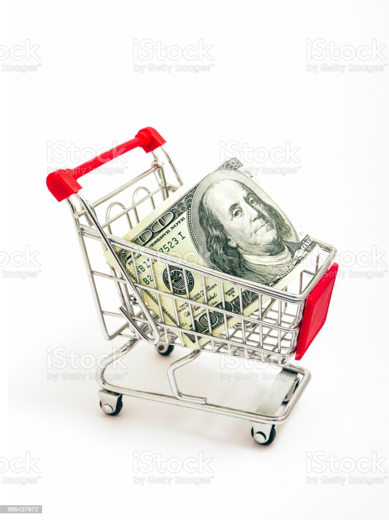 Metal basket with an American 100 dollar banknote in it. Consumption, shopping concept, pushcart. - Zbiór zdjęć royalty-free (Banknot)