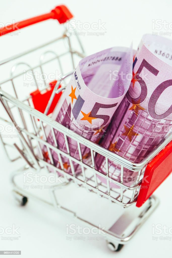 Metal basket with an Euro 500 banknote in it. Consumption, shopping concept, pushcart. zbiór zdjęć royalty-free