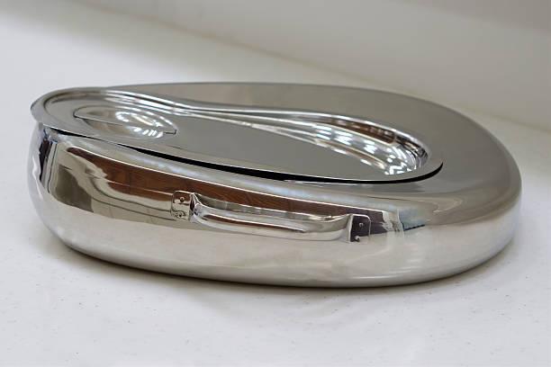 Metal bedpan stock photo