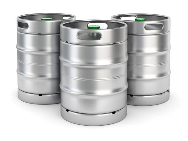 Metal beer kegs on white background stock photo