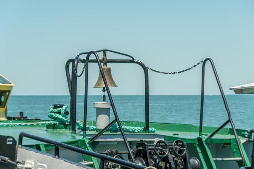 Metal bell on the ship; summer, sun, sea