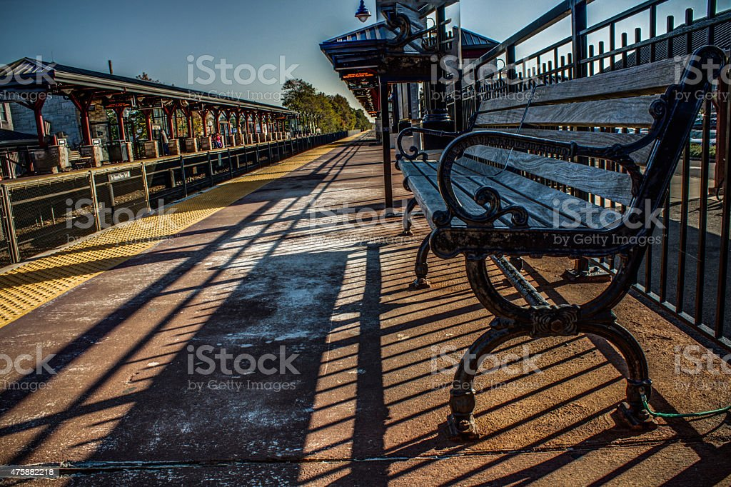 Metal bench at railway station stock photo