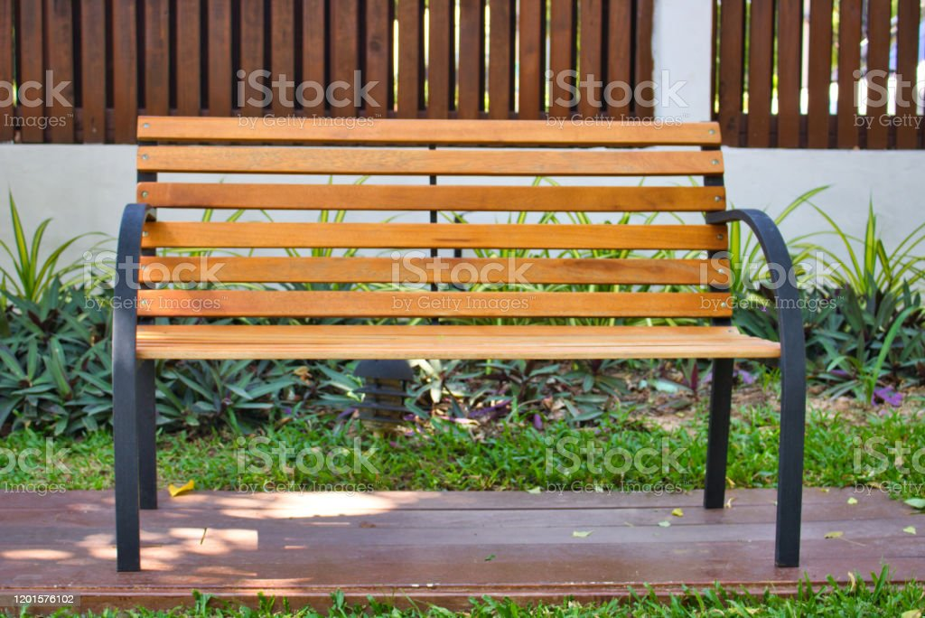 Picture of: Metal Bench With Wooden Seat In The Park Stock Photo Download Image Now Istock