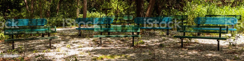 metal benches park relaxation arrea stock photo