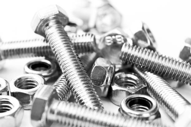 Metal bolts and nuts  in a row background. Chromed screw bolts and nuts isolated. Steel bolts and nuts pattern. Set of Nuts and bolts. Tools for work. Black and white Metal bolts and nuts  in a row background. Chromed screw bolts and nuts isolated. Steel bolts and nuts pattern. Set of Nuts and bolts. Tools for work. Black and white bolt fastener stock pictures, royalty-free photos & images