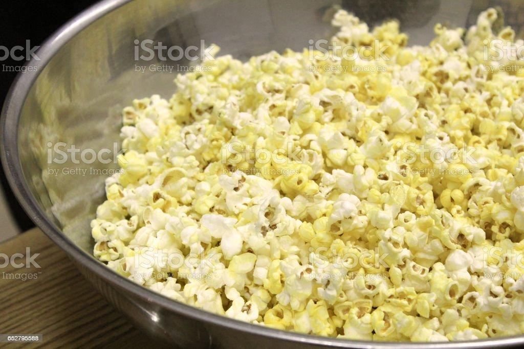 Metal bowl of popcorn ready to be eaten stock photo