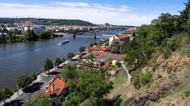 Metal bridge, Charles Bridge and Prague Castle from Vysehrad stock photo